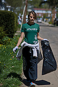 An Ohio University student volunteer walks down Palmer Street looking for an remaining trash during the Off Campus Living Fest Clean Up event Sunday, April 21, 2013. Students picked up trash long the sidewalks and grass to prevent trash build up after fest season came to a close for the school year with Palmer Fest, which was held the previous Saturday, April 20.
