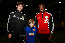 Kids pose with two of Bristol City's U18 Academy prospects at the Bristol City Community Trust Filton Holiday Camp - Photo mandatory by-line: Rogan Thomson/JMP - 07966 386802 - 19/02/2015 - SPORT - FOOTBALL - Bristol, England - SGS Wise Campus.