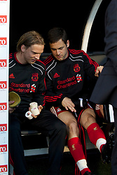 LONDON, ENGLAND - Monday, May 9, 2011: Liverpool's substitutes Christian Poulsen and Joe Cole before the Premiership match against Fulham at Craven Cottage. (Photo by David Rawcliffe/Propaganda)