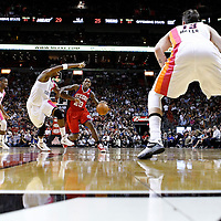 21 January 2012: Philadelphia Sixers point guard Lou Williams (23) drives past Miami Heat power forward Chris Bosh (1) during the Miami Heat 113-92 victory over the Philadelphia Sixers at the AmericanAirlines Arena, Miami, Florida, USA.