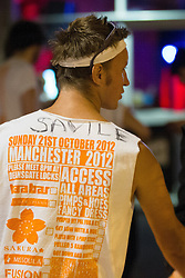 "© Licensed to London News Pictures . 21/10/2012 . Manchester , UK . A student with "" Savile "" written on his Carnage UK t-shirt . Students attend a Carnage UK pub crawl at bars in Manchester 's Deansgate Locks with a fancy dress theme of "" Pimps and Hoes "" . The event has been criticised for encouraging binge drinking , sexism and anti-social behaviour . Photo credit : Joel Goodman/LNP"