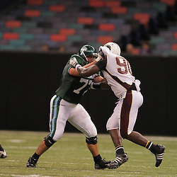 20 September 2008: Tulane tackle Troy Kropog (77) blocks Louisiana-Monroe defensive tackle DeMarcus Carmouche (90) during a Conference USA match up between the University of Louisiana Monroe and Tulane at the Louisiana Superdome in New Orleans, LA.