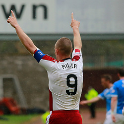 Kenny Miller Heads back ti the centre of the park whilst saluting the fans