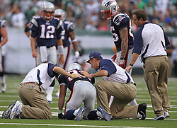 Sept 19, 2011; East Rutherford, NJ, USA; New England Patriots wide receiver Wes Welker (83) is shaken up after being hit by New York Jets safety Eric Smith (33) during the 1st half at the New Meadowlands Stadium.