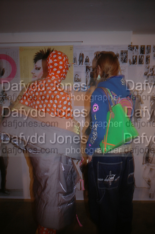 Andre Bartenev and Irena Zhivago. i-Dentity opening. Celebrating 25 years of i-D. Fashion and Textile magazine. Ber5mondsey St. London. SE1. 13 October  2005. ONE TIME USE ONLY - DO NOT ARCHIVE © Copyright Photograph by Dafydd Jones 66 Stockwell Park Rd. London SW9 0DA Tel 020 7733 0108 www.dafjones.com
