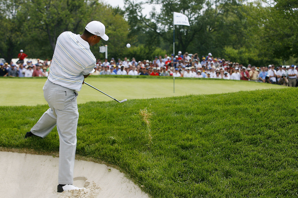 Tiger Woods of the US chips from the rough on the first hole during the second day of the US Open Golf Championship at Winged Foot Golf Club in Mamaroneck, New York Friday, 16 June 2006.