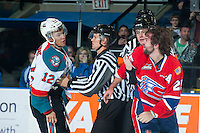 KELOWNA, CANADA - MARCH 7: Riley Whittingham #25 of Spokane Chiefs drops the gloves with Tyrell Goulbourne #12 of Kelowna Rockets on March 7, 2015 at Prospera Place in Kelowna, British Columbia, Canada.  (Photo by Marissa Baecker/Shoot the Breeze)  *** Local Caption *** Tyrell Goulbourne; Riley Whittingham;