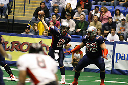 14 April 2007: Nick Ruud provides protection for a pass thrown by Steve Lafalce during a United Indoor Football League game that pitted the RiverCity Rage who won 29-11 against the Bloomington Extreme at the U.S. Cellular Coliseum in Bloomington Illinois..