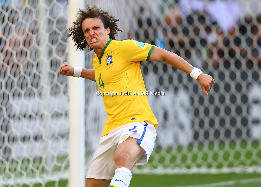 David Luiz of Brazil celebrates scoring the first penalty in the shoot out