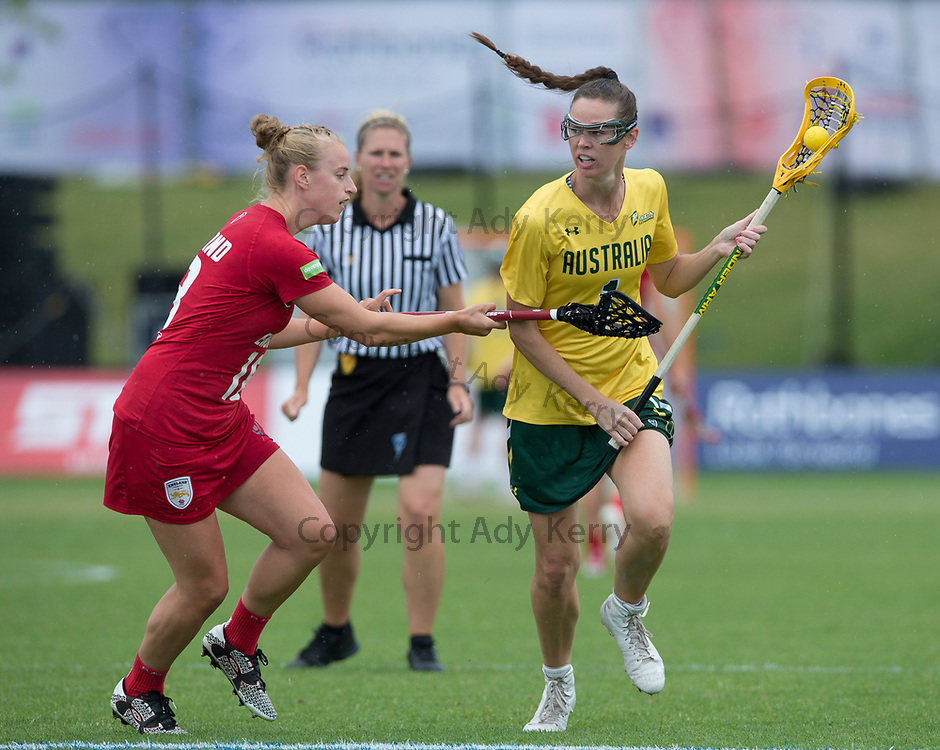 England's Emma Oakley challenges with Australia's Abbie Burgess in the bronze medal match which they won with a Golden Goal in extra time at the 2017 FIL Rathbones Women's Lacrosse World Cup, at Surrey Sports Park, Guildford, Surrey, UK, 22nd July 2017.