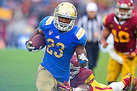 17 October 2012: Tailback (23) Jonathan Franklin of the UCLA Bruins runs the ball and scores a touchdown against the USC Trojans during the second half of UCLA's 38-28 victory over USC at the Rose Bowl in Pasadena, CA.
