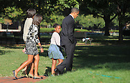Sasha Obama looks back at the photographer as the First Family walks across LaFayette Park to St. John's Episcopal Church on September 19, 2010.  IPhotograph by Dennis Brack