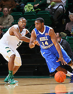 Dec 07, 2011; Birmingham, AL, USA;  Middle Tennessee Blue Raiders guard Marcos Knight (14) controls the ball as UAB Blazers guard Robert Williams  (5) guards him at Bartow Arena. The Blazers defeated the Blue Raiders 66-56 Mandatory Credit: Marvin Gentry-