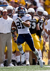 Virginia wide receiver Andrew Pearman (21) returns a kick return against Wyoming.  The Wyoming Cowboys defeated the Virginia Cavaliers 23-3 at War Memorial Stadium in Laramie, WY on September 1, 2007.
