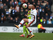 Brighton defender Bruno Saltor & Milton Keynes Dons midfielder Josh Murphy compete for a high ball during the Sky Bet Championship match between Milton Keynes Dons and Brighton and Hove Albion at stadium:mk, Milton Keynes, England on 19 March 2016. Photo by Bennett Dean.