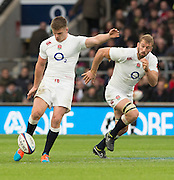 Twickenham, Great Britain, Owen FARRELL, kicking with Chris ROBSON, running into the space during the QBE Autumn Internationals, England vs New Zealand, RFU Stadium Twickenham, Surrey.  Saturday  08/11/2014 [Mandatory Credit; Peter SPURRIER/Intersport Images]