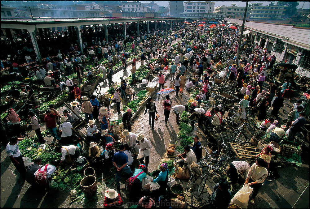 Sunday is the big market day in Menghan, China. Menghan is near Jinhong, on the border with Burma. (Supporting image from the project Hungry Planet: What the World Eats.) Grocery stores, supermarkets, and hyper and megamarkets all have their roots in village market areas where farmers and vendors would converge once or twice a week to sell their produce and goods. In farming communities, just about everyone had something to trade or sell. Small markets are still the lifeblood of communities in the developing world.