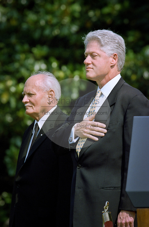 US President Bill Clinton stands with Hungarian President Arpad Goncz during a state arrival ceremony at the White House June 8, 1999.