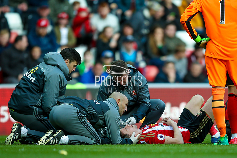 Sunderland defender Billy Jones (2) lies badly injured and waits for a stretcher during the Premier League match between Sunderland and West Ham United at the Stadium Of Light, Sunderland, England on 15 April 2017. Photo by Simon Davies.