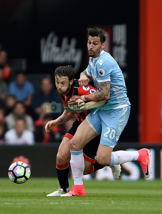 AFC Bournemouth's Harry Arter (left) and Stoke City's Geoff Cameron (right) battle for the ball