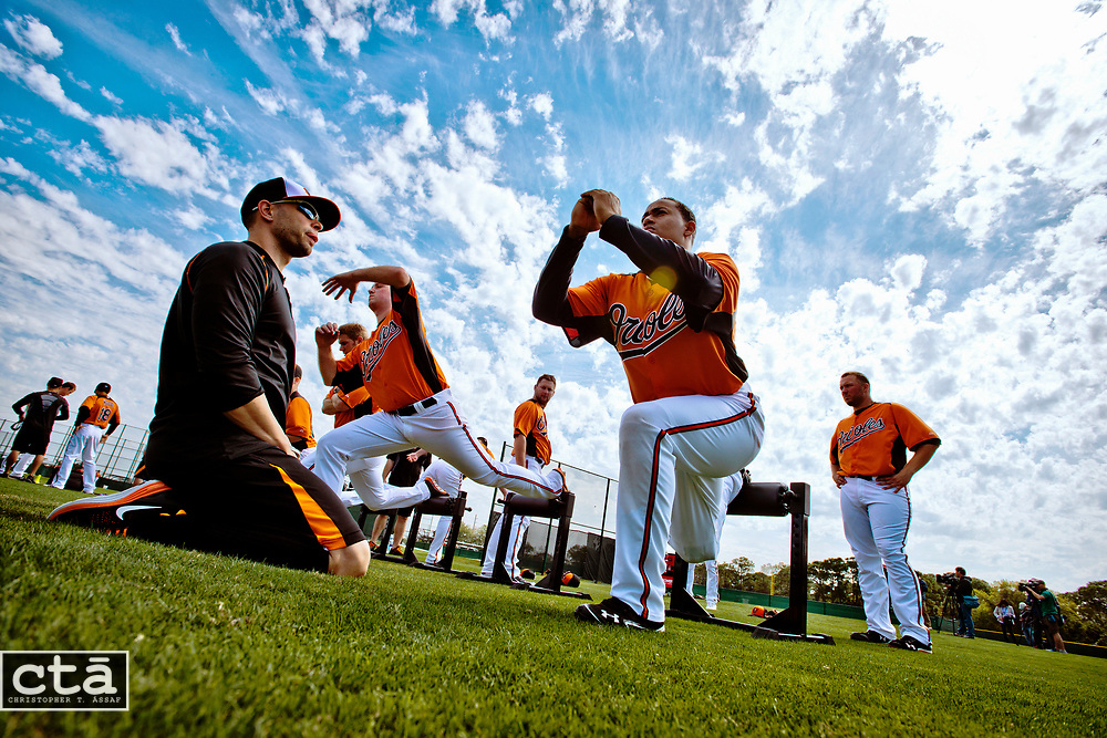 Pitcher Jair Jurrgens (48) stretches on Field 1 with his teammates for the first time after being acquired by the Orioles. Jurrgens, coming off an injury, signed a minor league contract.