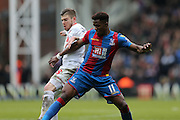 Liverpool defender Alberto Moreno (18)  battles with Crystal Palace forward Wilfried Zaha  during the Barclays Premier League match between Crystal Palace and Liverpool at Selhurst Park, London, England on 6 March 2016. Photo by Simon Davies.