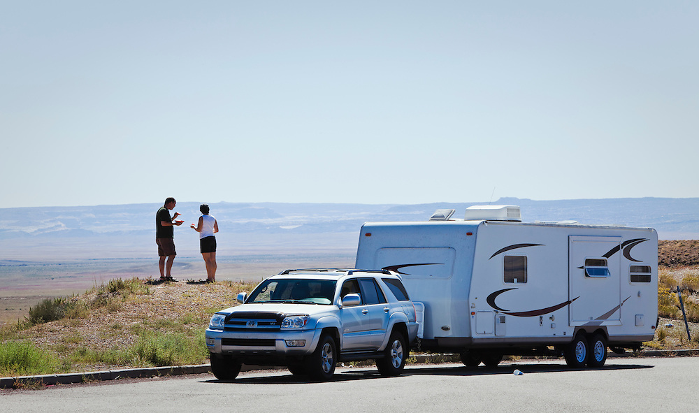 A middle aged couple stopping at a rest area for a little snack and site seeing in central Utah along Interstate Highway 70.