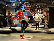 """American Dream"" (2009) stylish car part dress by Sarah Thomas. WOW, World of Wearable Art (TM) is New Zealand's largest arts show. This showcase of work emerges from WOW, a spectacular international design competition where art and fashion intersect. This July 8, 2016 photo is from an exhibition at the EMP Museum, now called MOPOP (Museum of Pop Culture), Seattle, Washington, USA."