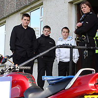 Tayside Police Western Division Road Policing Unit..18.10.07<br /> Mini-motorbike project at Perth Grammar School.  PC's John Quithen and Julie Robertson listen to project leader Pete Nicol with pupils from left, Danny Carmichael (14), Alan Harvey (13) and Franco Sinclair (13)<br /> Picture by Graeme Hart.<br /> Copyright Perthshire Picture Agency<br /> Tel: 01738 623350  Mobile: 07990 594431