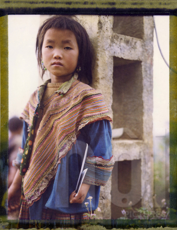 Polaroid 79's portrait of a young girl wearing tribal clothes.