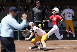 26 April 2015:   Kelsey Turczyn is thrown out ar first base as Tarran Shaffer grabs the put out throw during an NCAA Missouri Valley Conference (MVC) Championship series women's softball game between the Loyola Ramblers and the Illinois State Redbirds on Marian Kneer Field in Normal IL