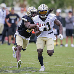 Jul 28, 2019; Metairie, LA, USA; New Orleans Saints running back Alvin Kamara (41) breaks loose from defensive back Chris Banjo (31) during training camp at the Ochsner Sports Performance Center. Mandatory Credit: Derick E. Hingle-USA TODAY Sports