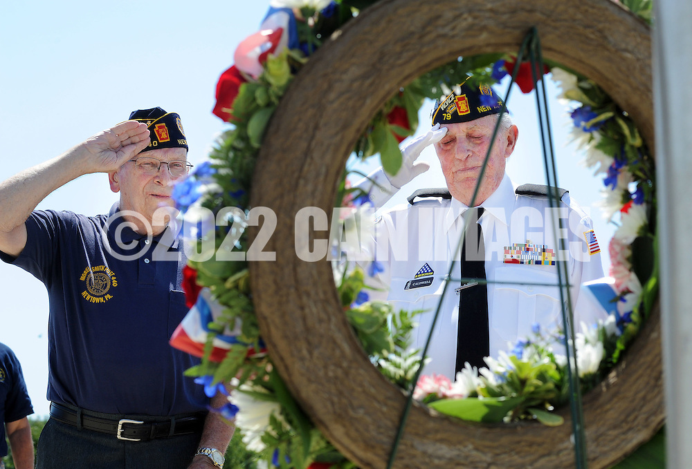 From left, Stanley Mathews of Upper Makefield, Pennsylvania and Fred Caldwell Churchill, Pennsylvania salute after a wreath was placed at Washington Crossing National Cemetery to commemorate the end of World War II or VJ Day Friday August 14, 2015 in Newtown, Pennsylvania. (Photo by William Thomas Cain)