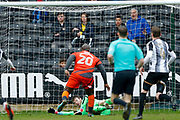 Notts County goalkeeper Adam Collin (1)  makes a point blank save from Wycombe Wanderers forward Adebayo Akinfenwa (20)  during the EFL Sky Bet League 2 match between Notts County and Wycombe Wanderers at Meadow Lane, Nottingham, England on 30 March 2018. Picture by Simon Davies.