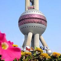 Oriental Pearl Tower in Shanghai, China<br /> The Oriental Pearl Tower is a stunning landmark in the Pudong district of Shanghai, China, the world's largest city with nearly 18 million people.  It was built in 1994 for radio and TV transmissions but is also home to restaurants, a mall, a hotel and an observation deck at over 1,100 feet. The design has 11 spheres, but the two large pink ones are the most prominent.