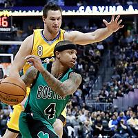 10 March 2017: Boston Celtics guard Isaiah Thomas (4) drives past Denver Nuggets forward Danilo Gallinari (8) during the Denver Nuggets 119-99 victory over the Boston Celtics, at the Pepsi Center, Denver, Colorado, USA.