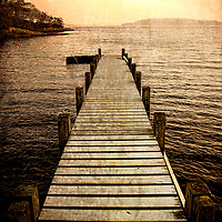 A wooden jetty overlooking a lake