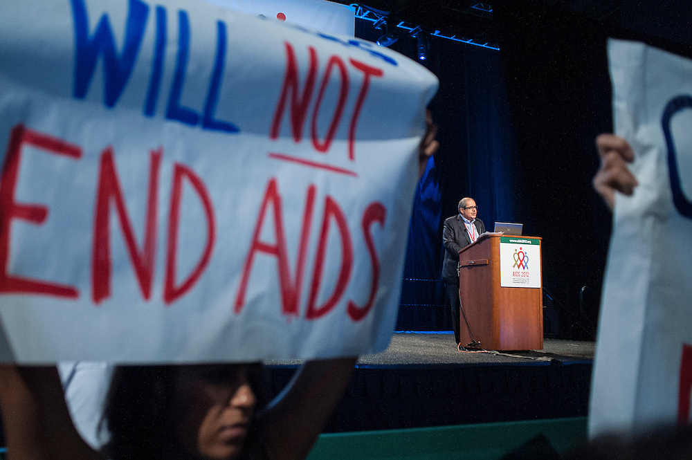 Activists against the new Global Fund strategic plan take the stage and disrupt General Manager Gabriel Jaramillo on Thursday at the 2012 International AIDS Conference in Washington, D.C.