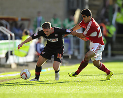 Brentford's Lee Hodson  battles for the ball with Swindon Town's Massimo Luongo - Photo mandatory by-line: Joe Meredith/JMP - Tel: Mobile: 07966 386802 04/05/2013 - SPORT - FOOTBALL - County Ground - Swindon - Swindon Town v Brentford - Npower League one Play Off