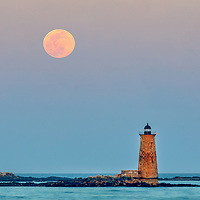 Whaleback Light with super worm moon in southern Maine near the New Hampshire border. This historic New England lighthouse is located near Portsmouth, NH and is also known as Whaleback Light or Whaleback Ledge Lighthouse. A rising full moon always attracts a lot of nature lovers and photographers alike and there was no difference last night. Originally, I was inspired by the tall and old lighthouse structure out in the ocean that tells the story of bracing the Atlantic Ocean for a century and more.   <br />