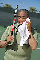 Tennis player toweling face