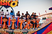 Oct. 21, 2009 -- PHOENIX, AZ: People ride the Disko on the midway at the Arizona State Fair in Phoenix, AZ. The fair runs through November 8.   Photo by Jack Kurtz