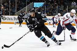 February 17, 2011; San Jose, CA, USA;  San Jose Sharks right wing Devin Setoguchi (16) skates with the puck past Washington Capitals center Brooks Laich (21) during the first period at HP Pavilion. Mandatory Credit: Jason O. Watson / US PRESSWIRE