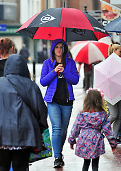 © Licensed to London News Pictures. 09/08/2018<br /> Tonbridge, UK. Umbrellas out and rain coats on for shoppers in Tonbridge High Street, Tonbridge, Kent as the heatwave across the south east comes to an end.<br /> Photo credit: Grant Falvey/LNP