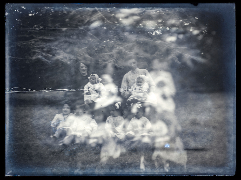 family portrait on double exposed  glass plate photo France ca 1920s