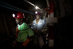 Gold miners work underground at the Great Noligwa Mine, run by Anglo Gold.  This mine has a dust reduction system in place in hopes of lowering the rate of silicosis.  Doctors have thus far found that while silica dust is reducing, silicosis remains constant, possibly owing to the latency of the disease. South African Gold miners are particularly vulnerable to contracting TB because of the small, poorly ventilated work and living conditions, high rates of HIV and high rates of silicosis, a lung disease often found in miners that increases the chance of having active TB.