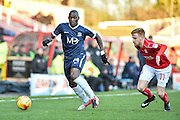 Southend United Forward, Marc-Antoine Fortune (14) gets away from Swindon Town Defender, James Brophy (11) during the EFL Sky Bet League 1 match between Swindon Town and Southend United at the County Ground, Swindon, England on 2 January 2017. Photo by Adam Rivers.