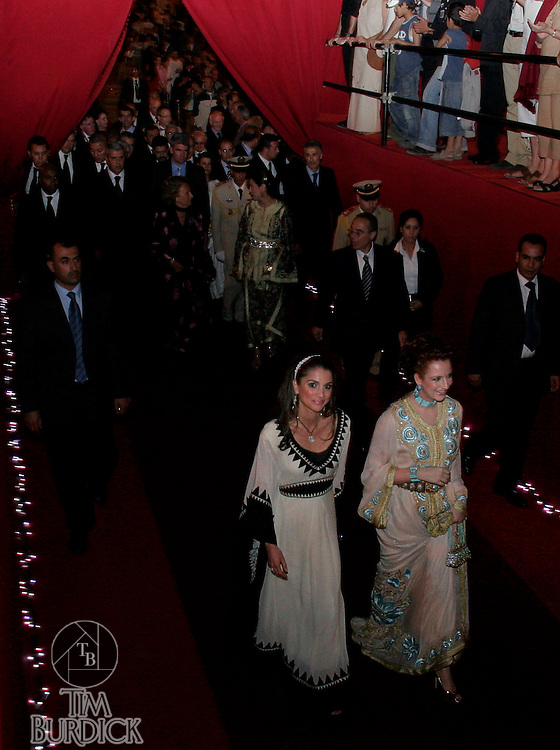 On the opening night of the Fes Festival of World Sacred Music in Fes, Morocco, Her Majesty Queen Rania Al-Abdullah of Syria, at left, and her Majesty Queen Salma Bennani of Morocco, at right, make a surprise entrance on the red carpet on Friday evening, June 01, 2007. (PHOTO BY TIMOTHY D. BURDICK).