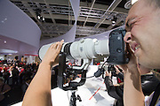 Photokina 2008, World's bigest bi-annual photo fair. A visitor trying out Canon's long glass.