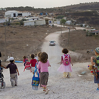 Israeli settler children make their way back home from the kindergarten in Havat Gilad.